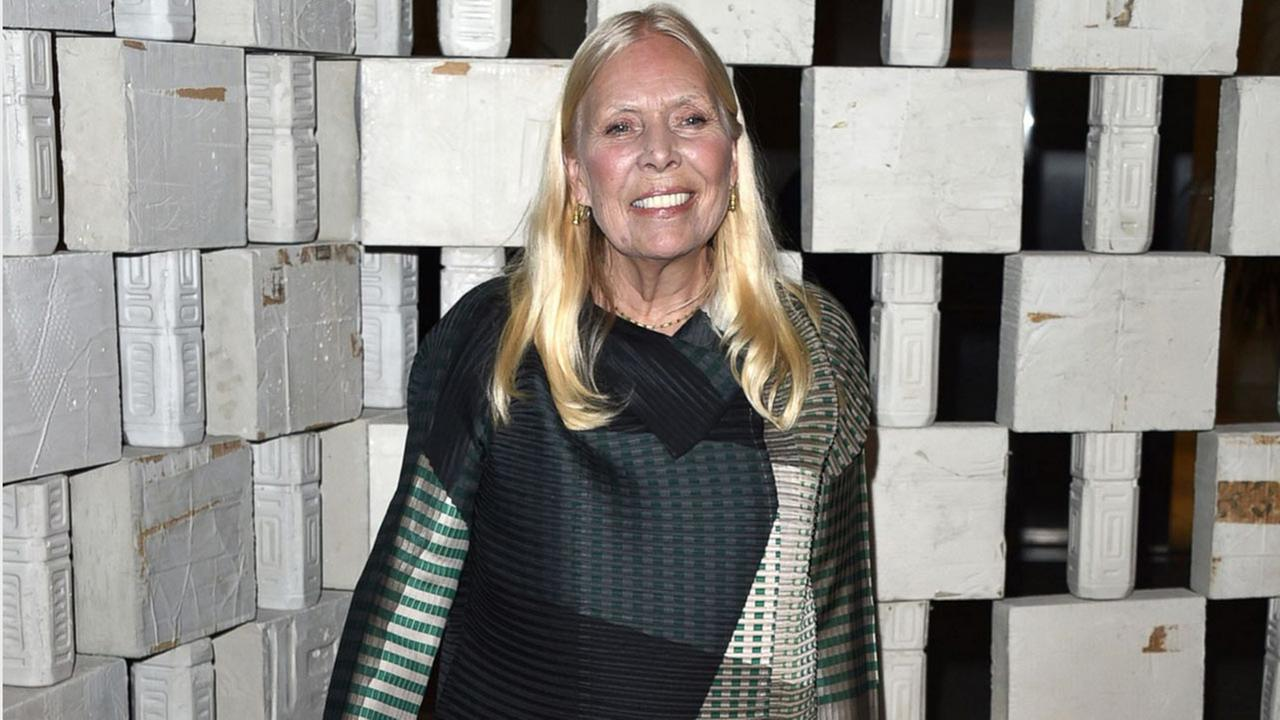 In this Oct. 11, 2014 file photo, Joni Mitchell arrives to the Hammer Museums Gala In The Garden, in Los Angeles.