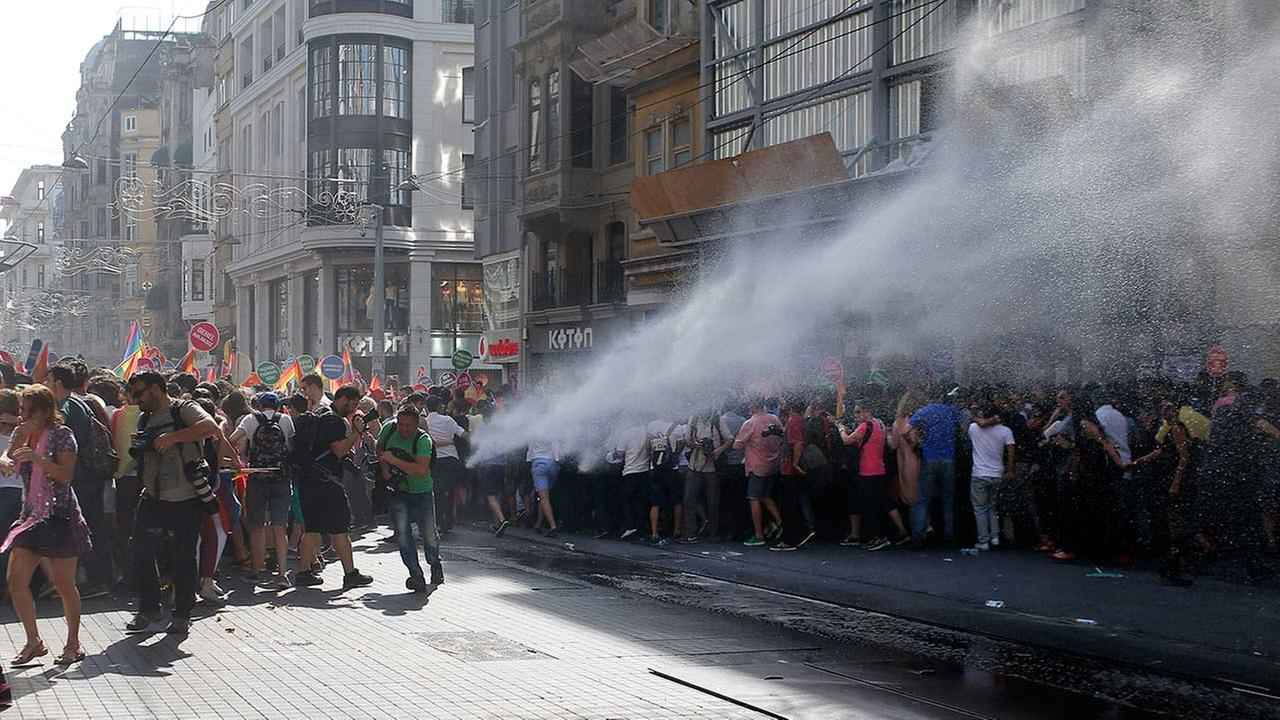 Turkish police use a water canon to disperse participants of a Gay Pride event in support of Lesbian, Gay, Bisexual and Transsexual rights in Istanbul, Sunday, June 28, 2015.