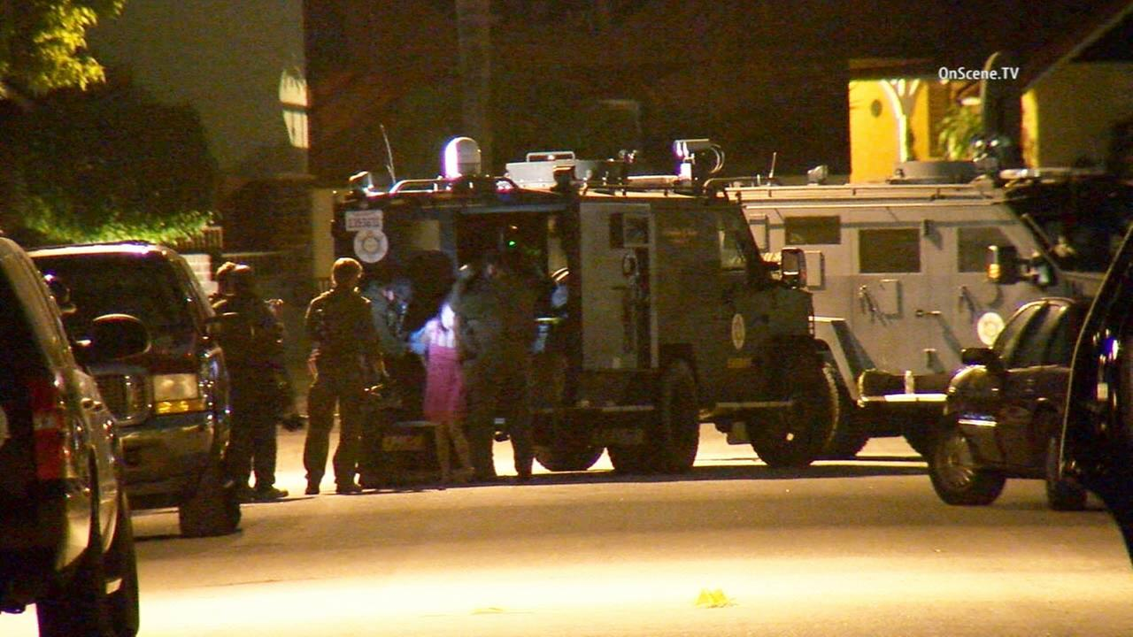 An armed woman was taken into custody Tuesday, June 30, 2015. after an hours-long standoff with sheriffs deputies in La Mirada.
