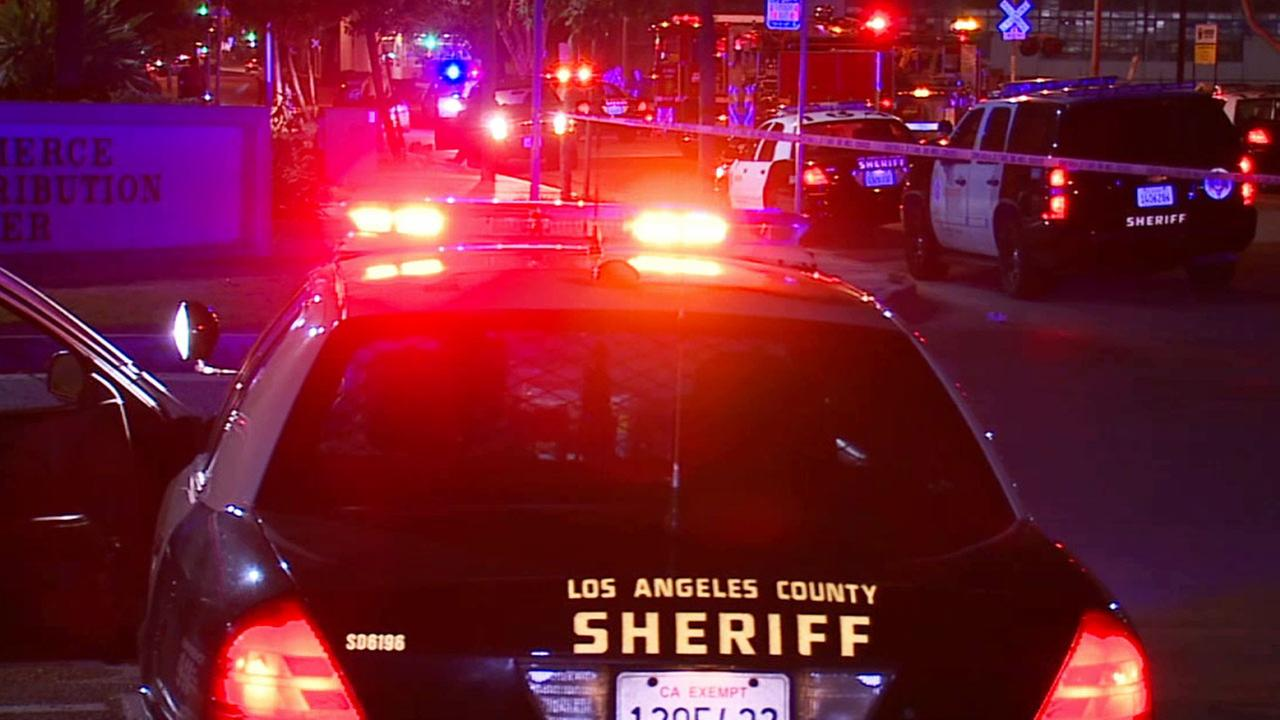 Los Angeles County sheriffs patrol vehicles are shown at the scene where a man was shot to death in Commerce on Tuesday, June 30, 2015.