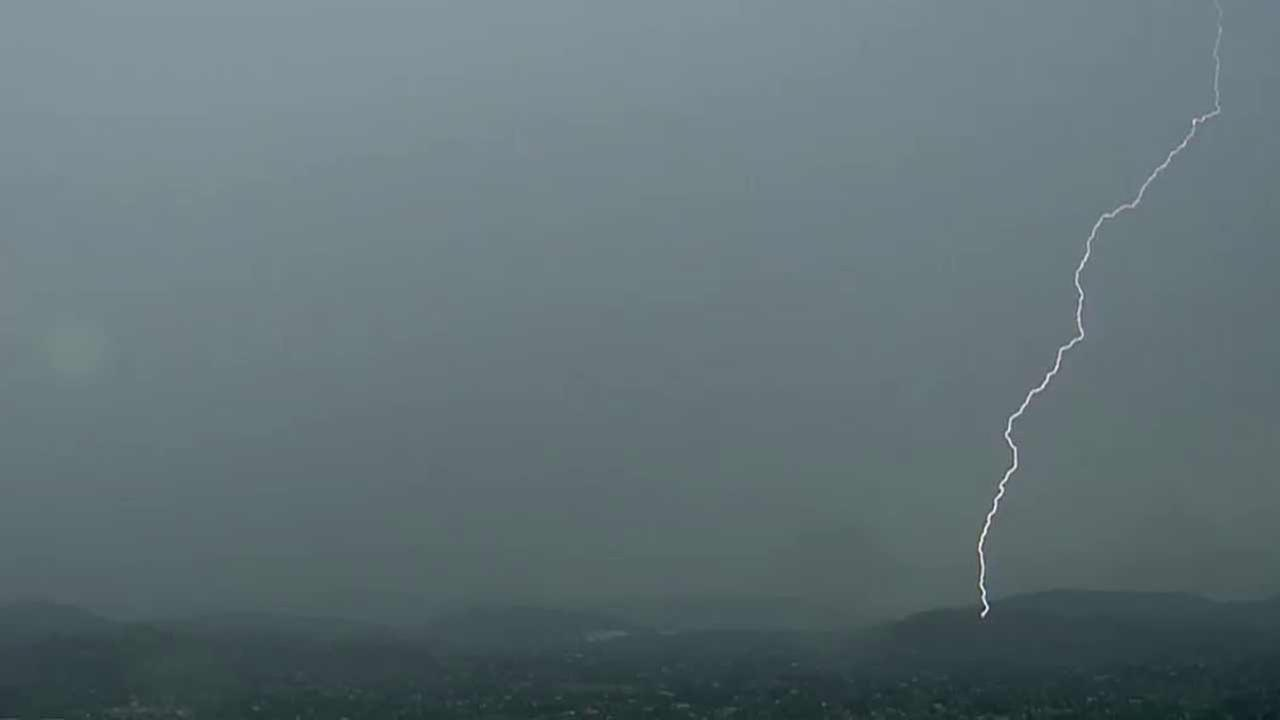 Monsoon thunderstorms brought heavy rain, gusty winds and powerful lightning strikes across parts of Southern California Tuesday, June 30, 2015.