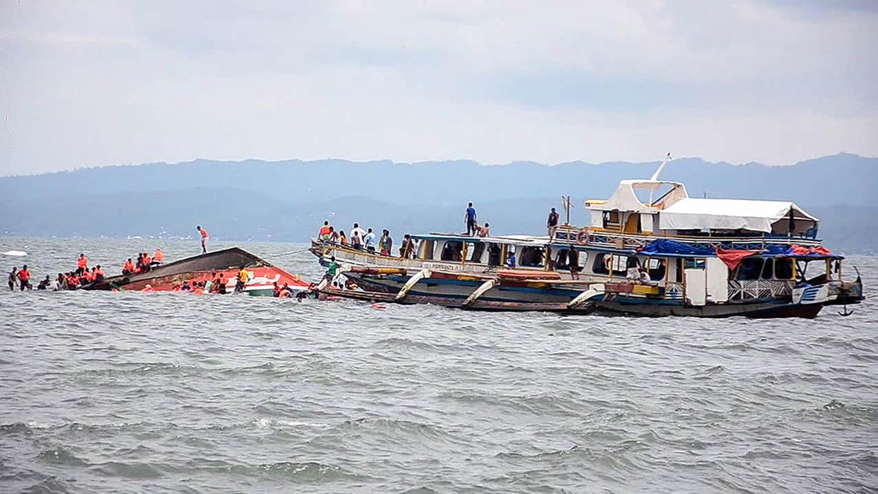 The Philippine Coast Guard rescues boat passengers after a ferry boat capsized in choppy waters, on Thursday, July 2, 2015, in Ornoc, Philippines.