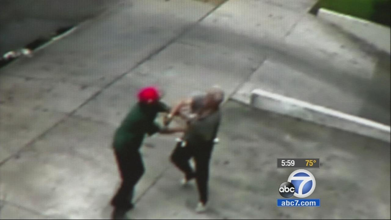 Santa Ana police are searching for two men who allegedly punched and robbed a 73-year-old man outside of his apartment complex Wednesday, July 1, 2015.