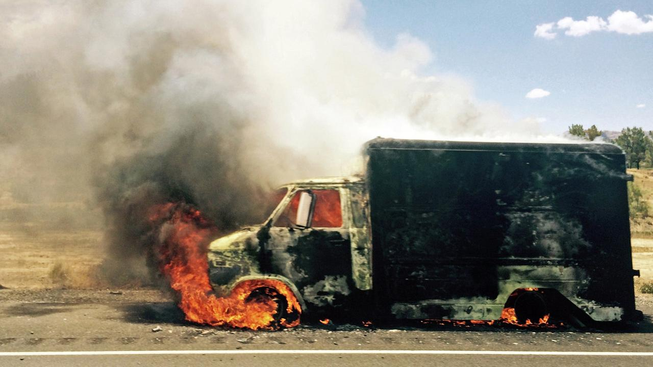 Smoke rises from a burning truck packed with fireworks after it exploded on Interstate 15 near Ivanpah, Calif., close to the Nevada state line Thursday, July 2, 2015.