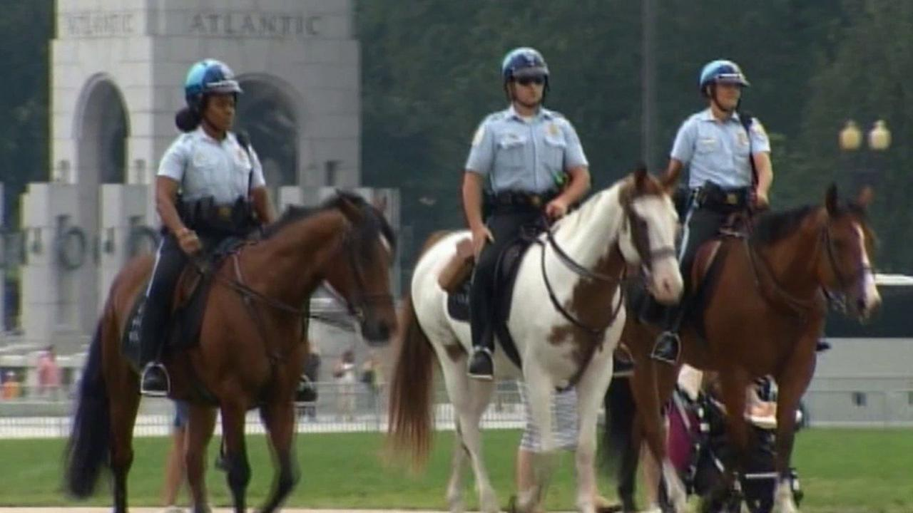 Authorities patrol a city on horses. Law enforcement agencies are on high alert for a possible terror threat during the Fourth of July weekend.