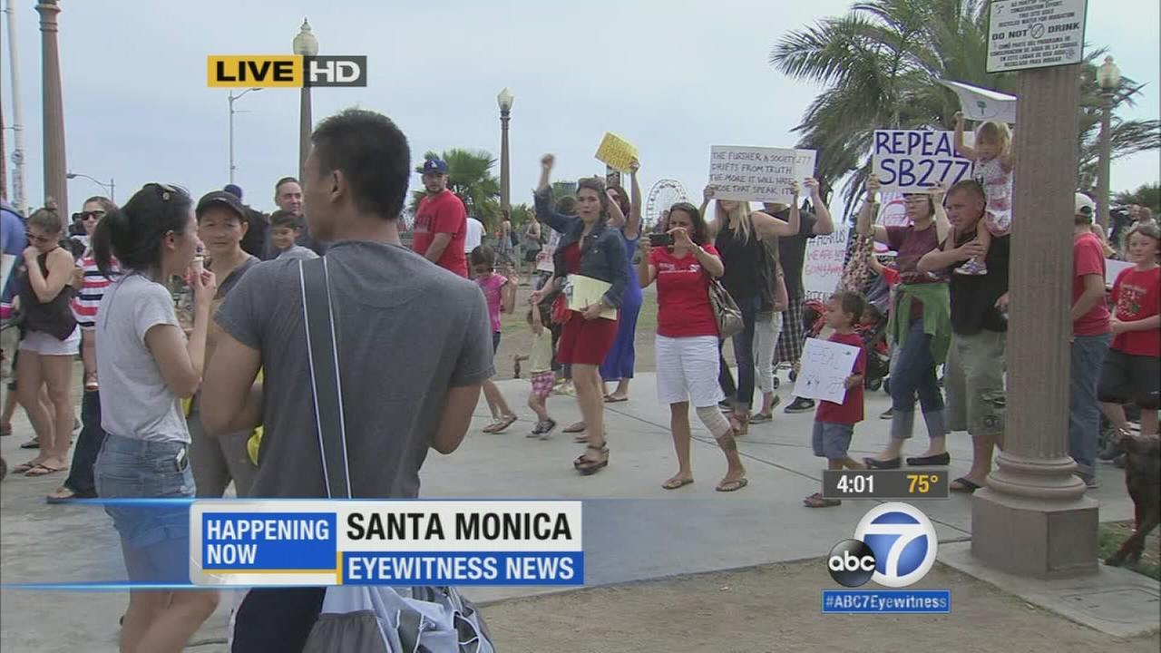 Hundreds of parents and activists converged at the Health Freedom Rally in Santa Monica Friday, July 3, 2015 to take a stand against SB277.