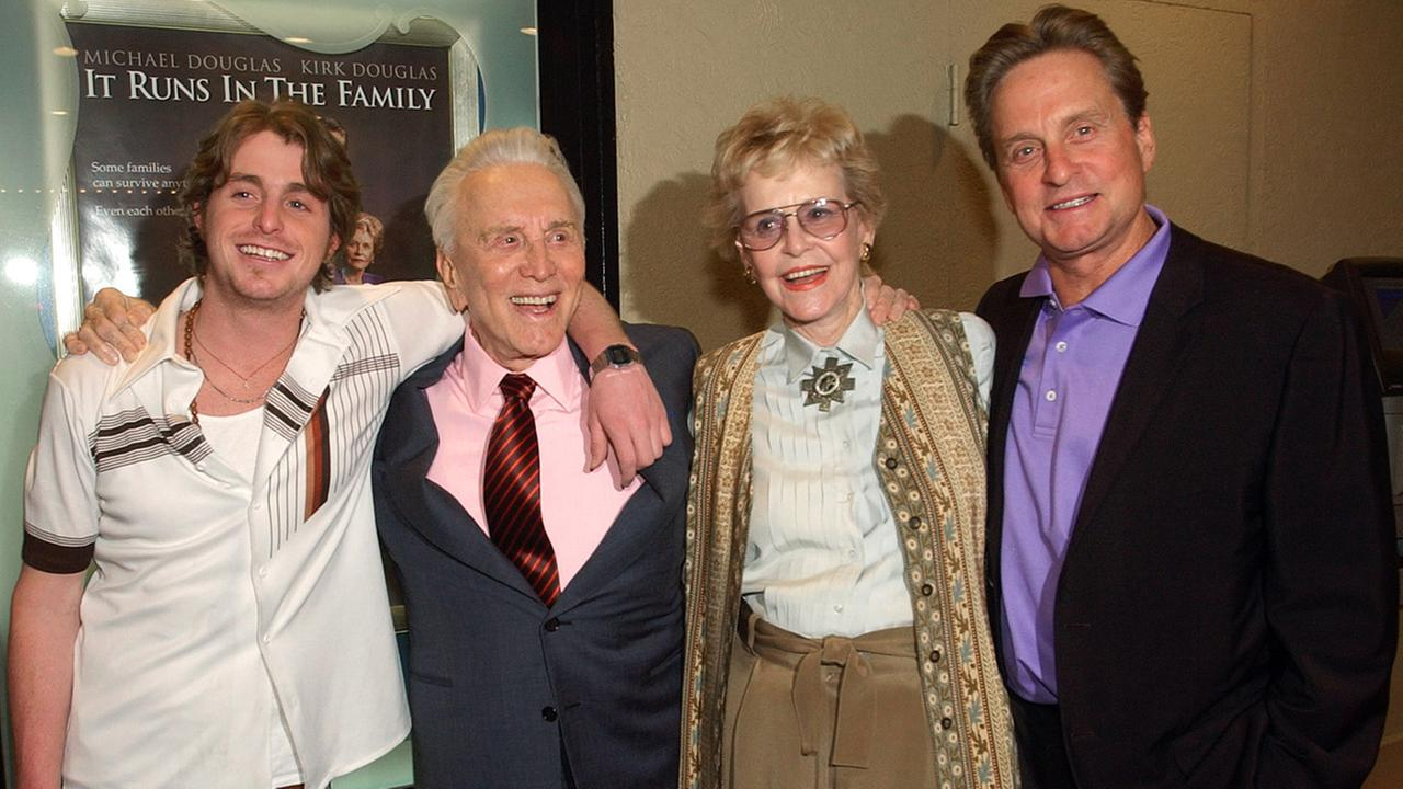 In this April 7, 2003 file photo, actor Kirk Douglas poses with his ex-wife Diana Douglas, their son Michael Douglas and Michaels son Cameron Douglas in Los Angeles.