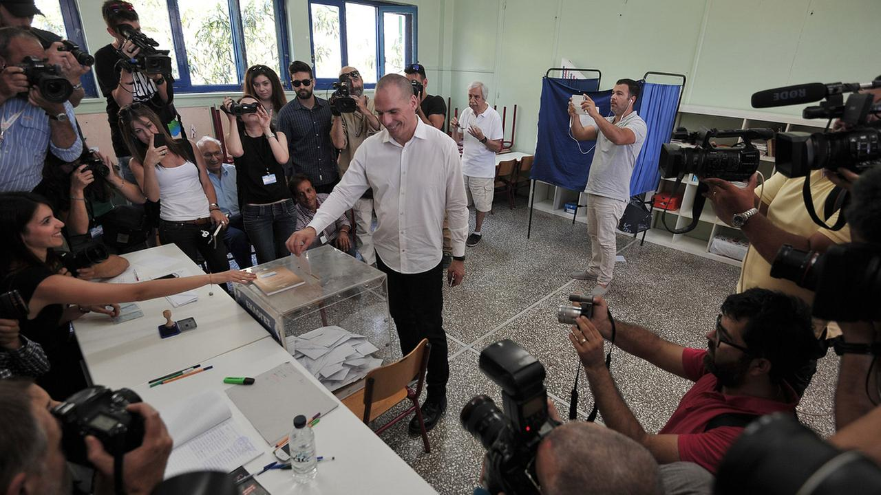Greeces Finance Minister Yanis Varoufakis casts his vote at a polling station in Athens, Sunday, July 5, 2015.