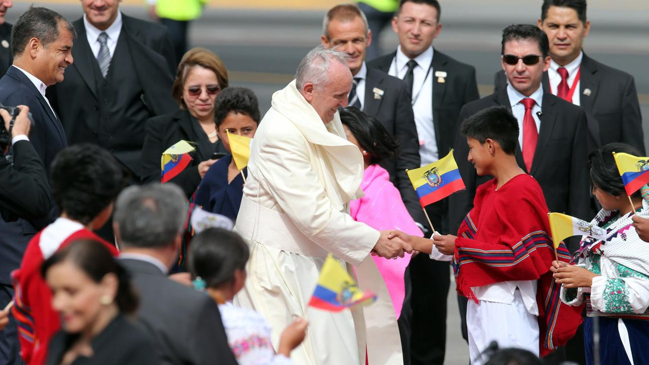 Pope Francis is greeted by children as well as Ecuadors President Rafael Correa upon his arrival to the Mariscal Sucre International airport in Quito, Ecuador on July 5, 2015.