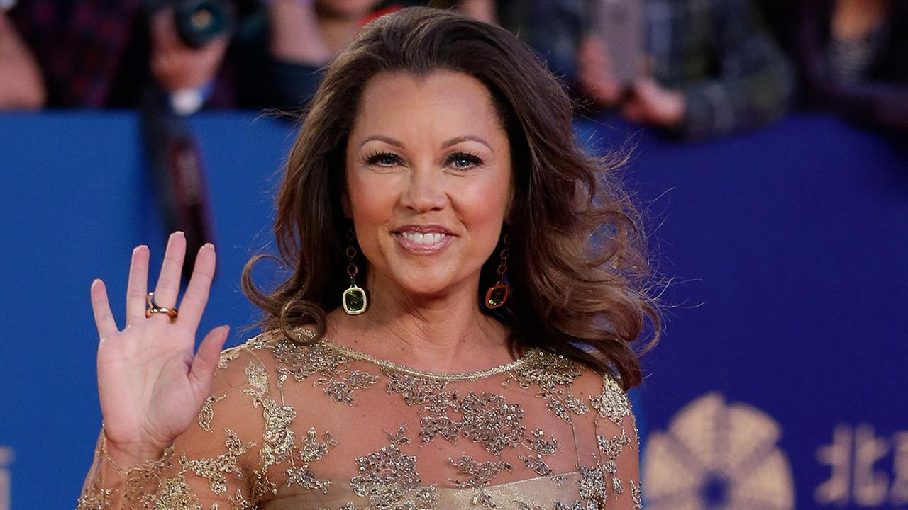 Vanessa Williams waves as she arrives on the red carpet for the closing ceremony of the 5th Beijing International Film Festival in the Huairou district of Beijing. Saturday, July 4, 2015.