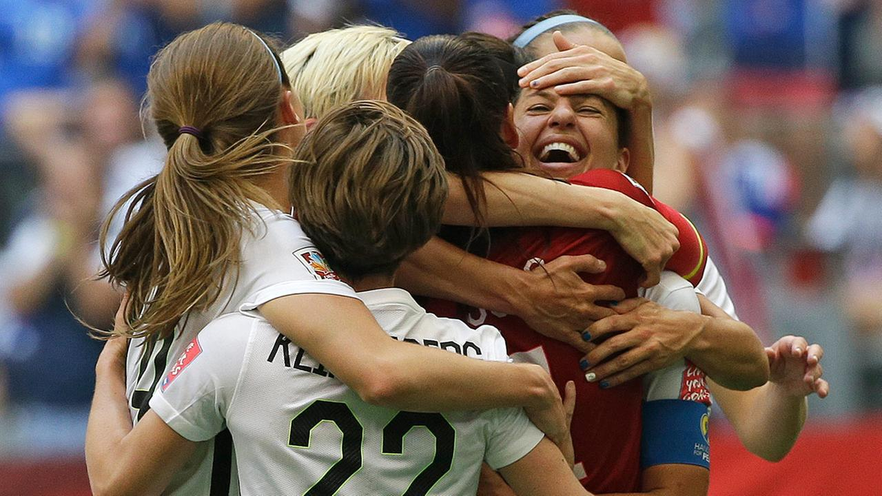 United States Carli Lloyd, right, celebrates with teammates after Lloyd scored her third goal against Japan during the first half of the FIFA Womens World Cup soccer championship in Vancouver, British Columbia, Canada, Sunday, July 5, 2015.