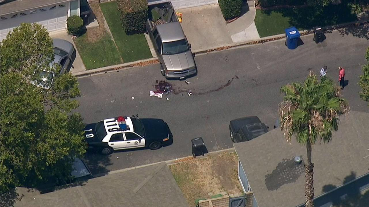 Police investigate a fatal stabbing and an officer-involved shooting in Sylmar on Monday, July 6, 2015.