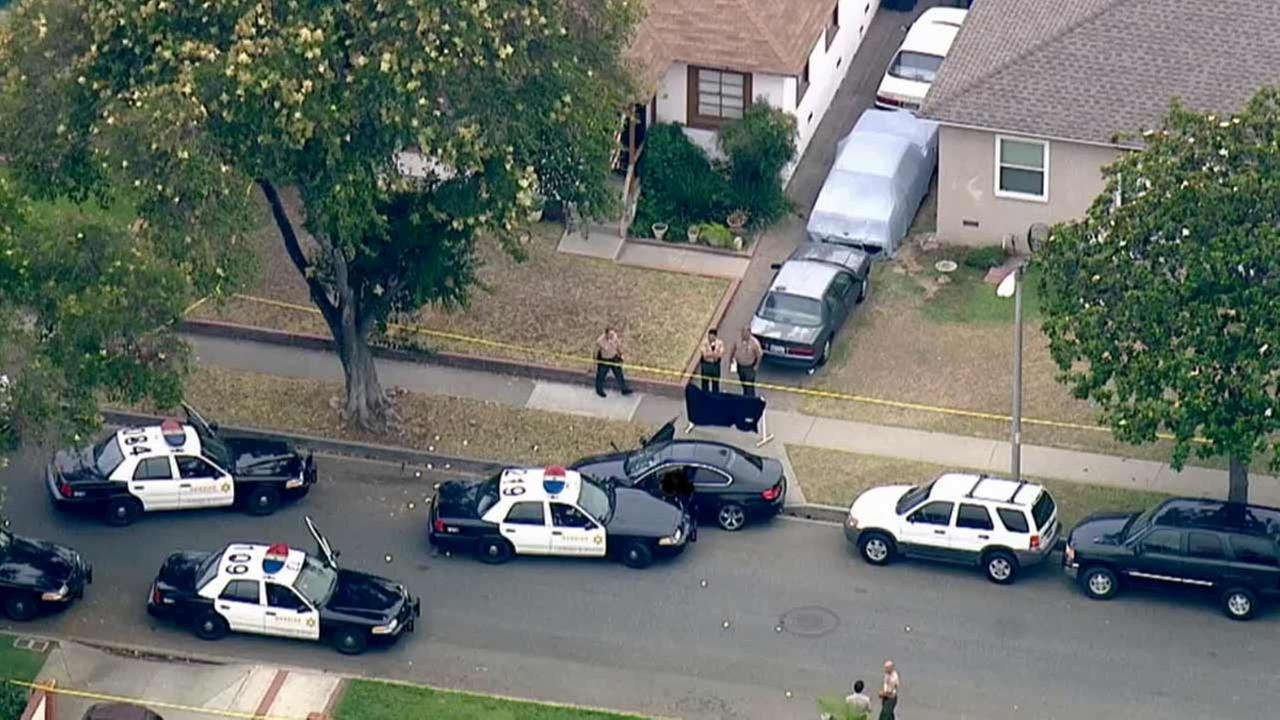 Los Angeles County sheriffs deputies investigate a fatal deputy-involved shooting in the 5500 block of Adenmoor Avenue in Lakewood Monday, July 6, 2015.