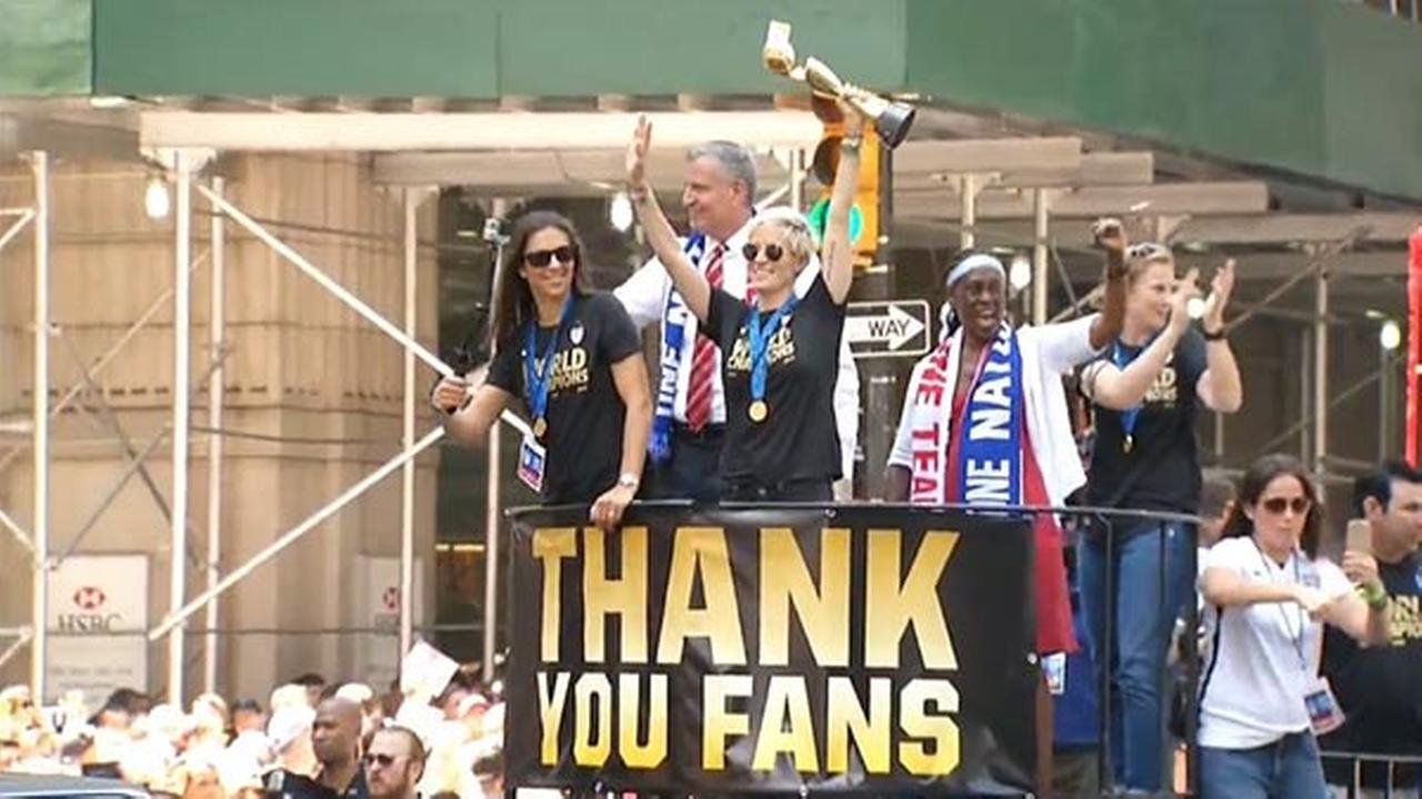 U.S. womens soccer team members wave to the crowd during the ticker-tape parade to celebrate the U.S. womens soccer team World Cup victory, Friday, July 10, 2015, in New York.