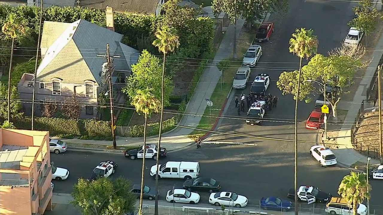 A search was underway for a burglary suspect after he fled on foot following the end of a police chase in the West Adams area on Monday, July 13, 2015.