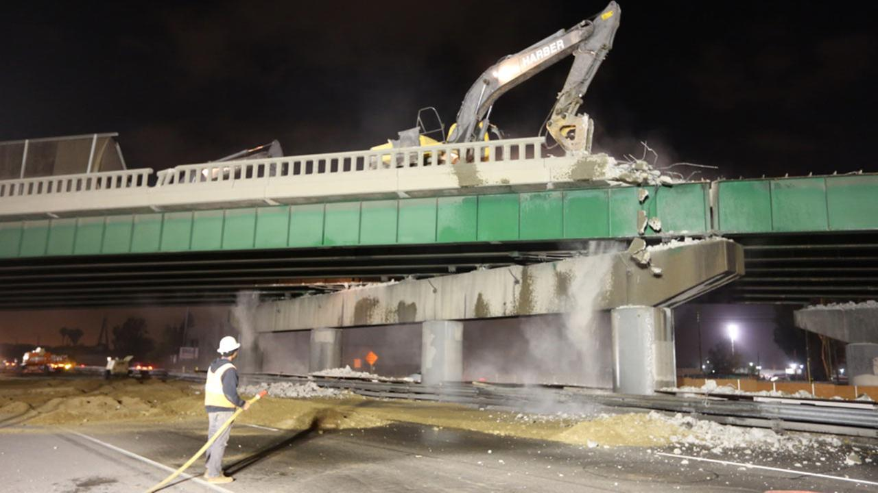 Crews work on the demolition of the Carmenita Road Bridge in this photo provided by the U.S. Department of Transportation.
