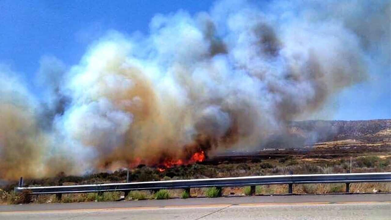 A fast-moving brush fire erupted in the median of the 15 Freeway just north of State Route 138 near Oak Hill Road in the Cajon Pass Friday, July 17, 2015. https://twitter.com/SBCOUNTYFIRE