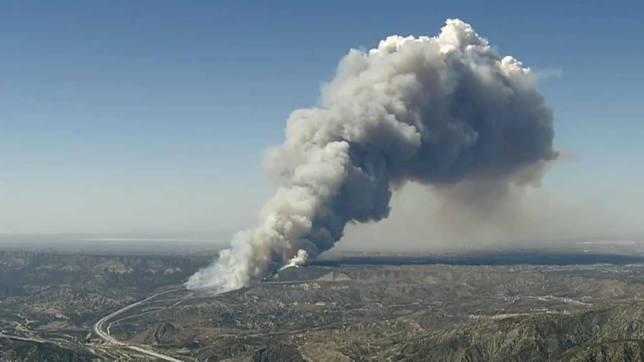 An aerial view of the North Fire which erupted next to the 15 Freeway at Oak Hill Road in the Cajon Pass on Friday, July 17, 2015.