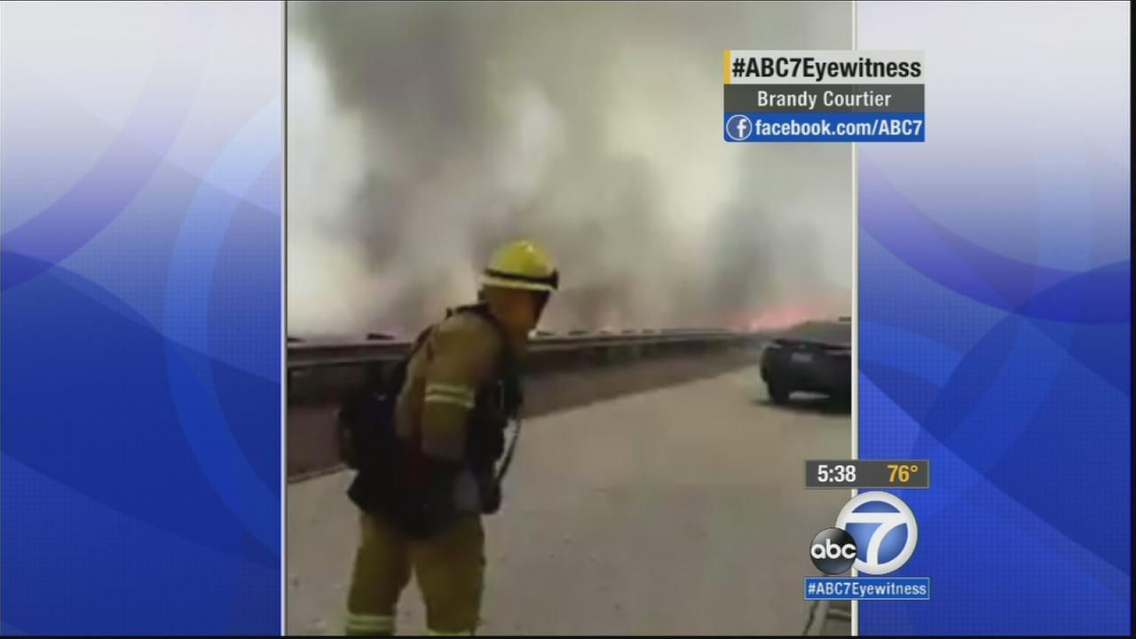 A video captured the frantic moments as motorists hesitated on whether to abandon their vehicles on the 15 Freeway in the Cajon Pass Friday, July 17, 2015.