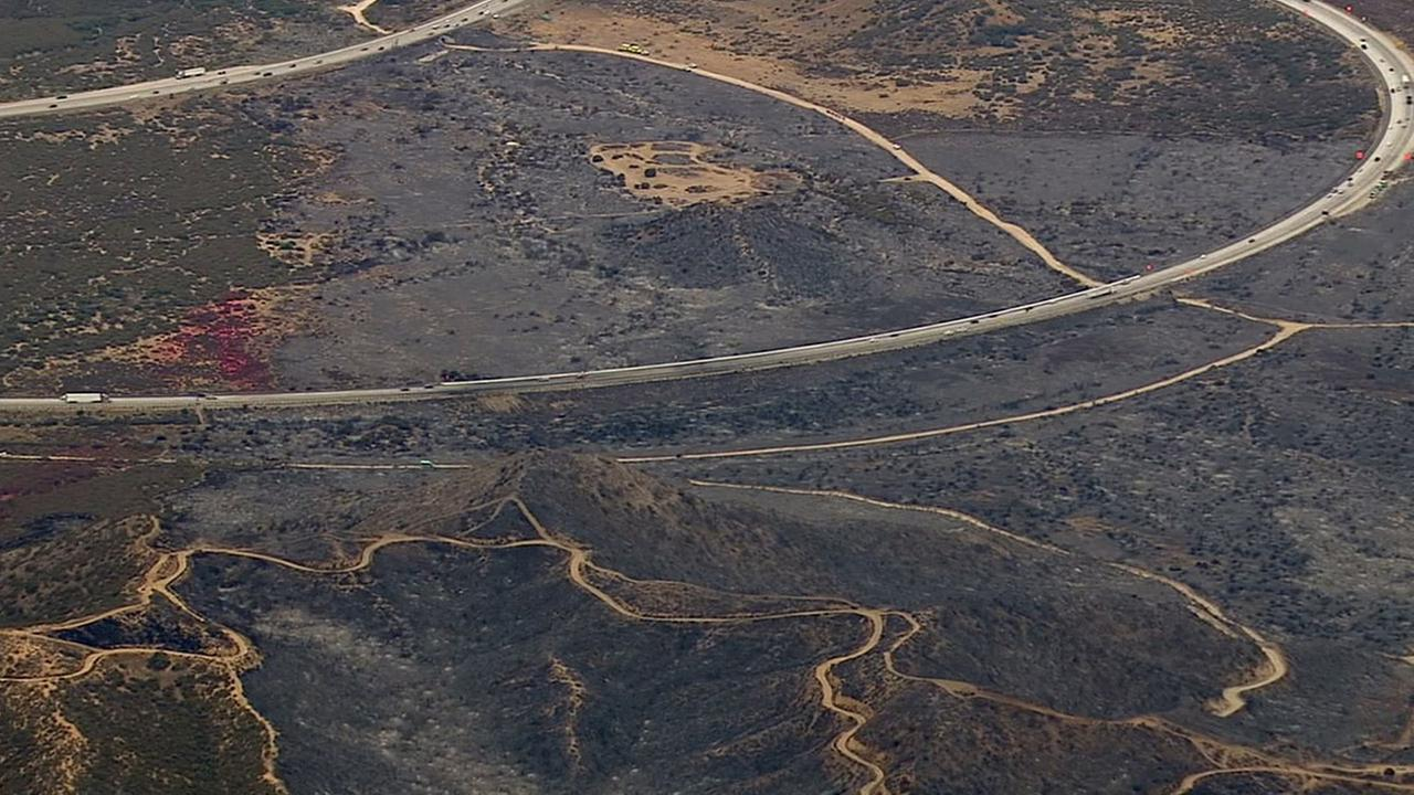 Images captured by AIR7 HD show charred acres of the North Fire near the 15 Freeway in the Cajon Pass on Saturday, July 18, 2015.KABC
