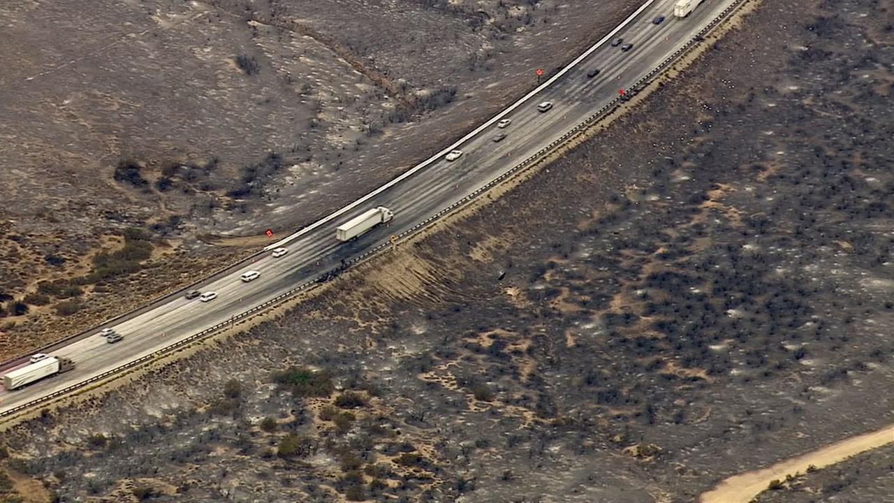 Drivers pass through the 15 Freeway, which was damaged by the North Fire, on Saturday, July 18, 2015.KABC