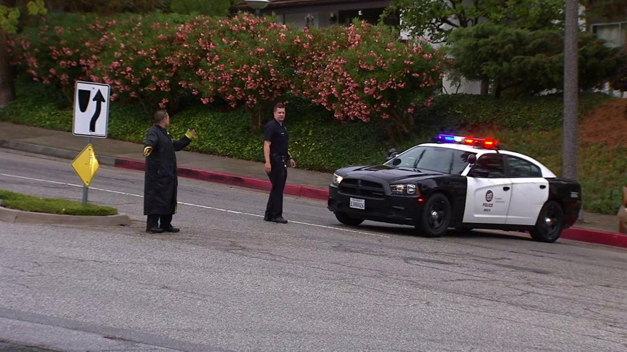 Authorities shut evacuated a neighborhood in Pacific Palisades after a large amount of weapons and ammunition was found on Saturday, July 18, 2015.