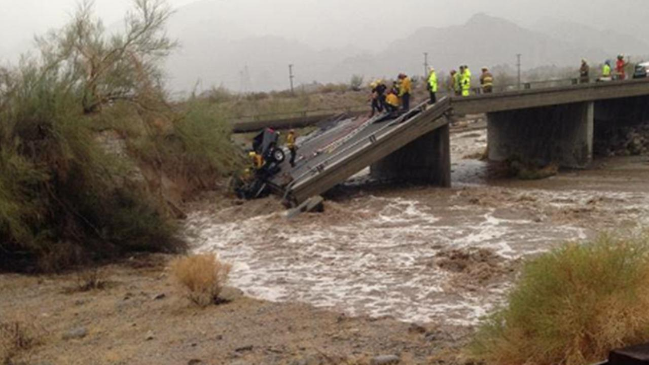 Firefighters pull a vehicle out of flood waters on the 10 Freeway at Desert Center on Sunday, July 19, 2015.
