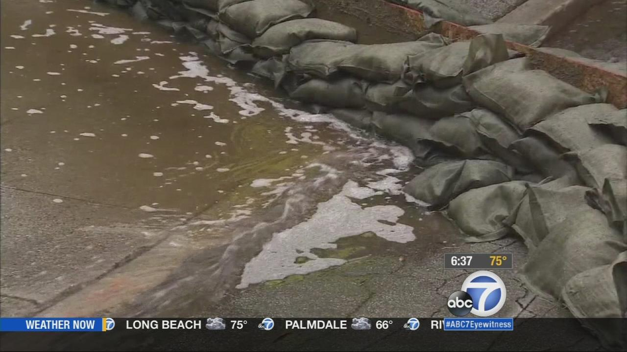 Sudden downpours caused flooding for many cities across Los Angeles County as a rain-making system moved across the region.