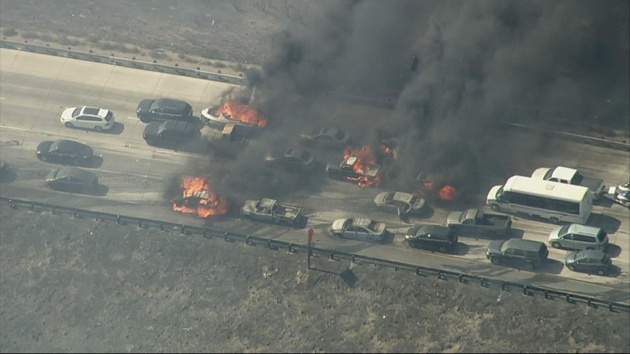 Cars were engulfed in flames on the 15 Freeway in the Cajon Pass on Friday, July 17, 2015.