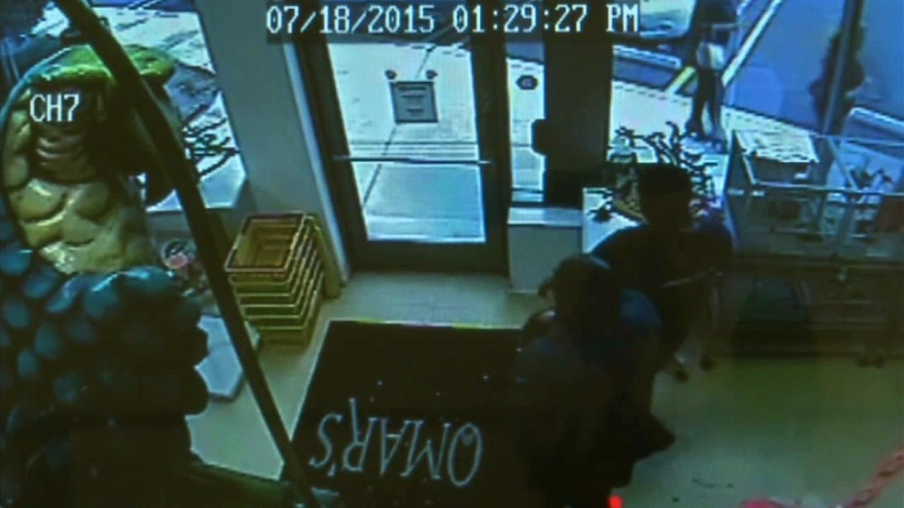Surveillance video catches two men walking out of a Brea pet store with a $1,600 parrot on Saturday, July 18, 2015.