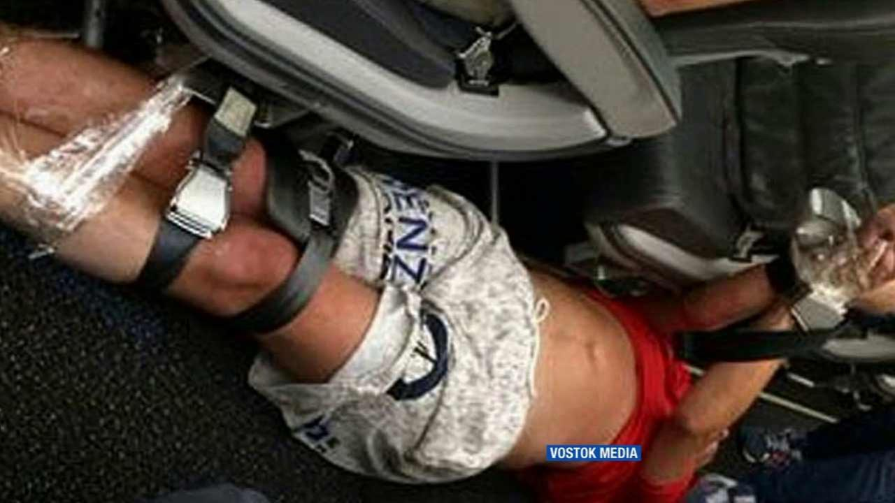 An unruly passenger was restrained with seat belts on Siberia Airlines Flight 546 from Hong Kong to Vladivostok, Russia on Monday, July 20, 2015.