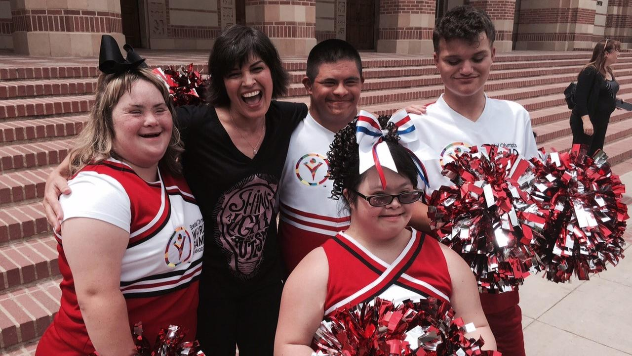 Eye on L.A. host Tina Malave poses for a photo with Special Olympics World Games cheerleaders.