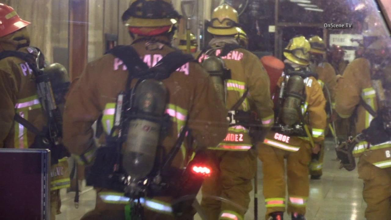 Firefighters arrive at the Pasadena Courthouse after a 2-alarm blaze broke out on the third floor of the building on Monday, July 27, 2015.