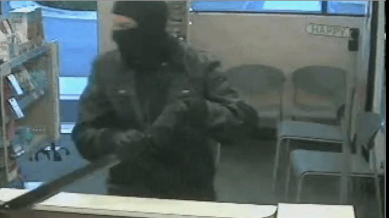A robbery suspect wearing a ninja mask and carrying a sword is shown on surveillance video captured at a Walgreens Pharmacy on Wednesday, July 29, 2015.