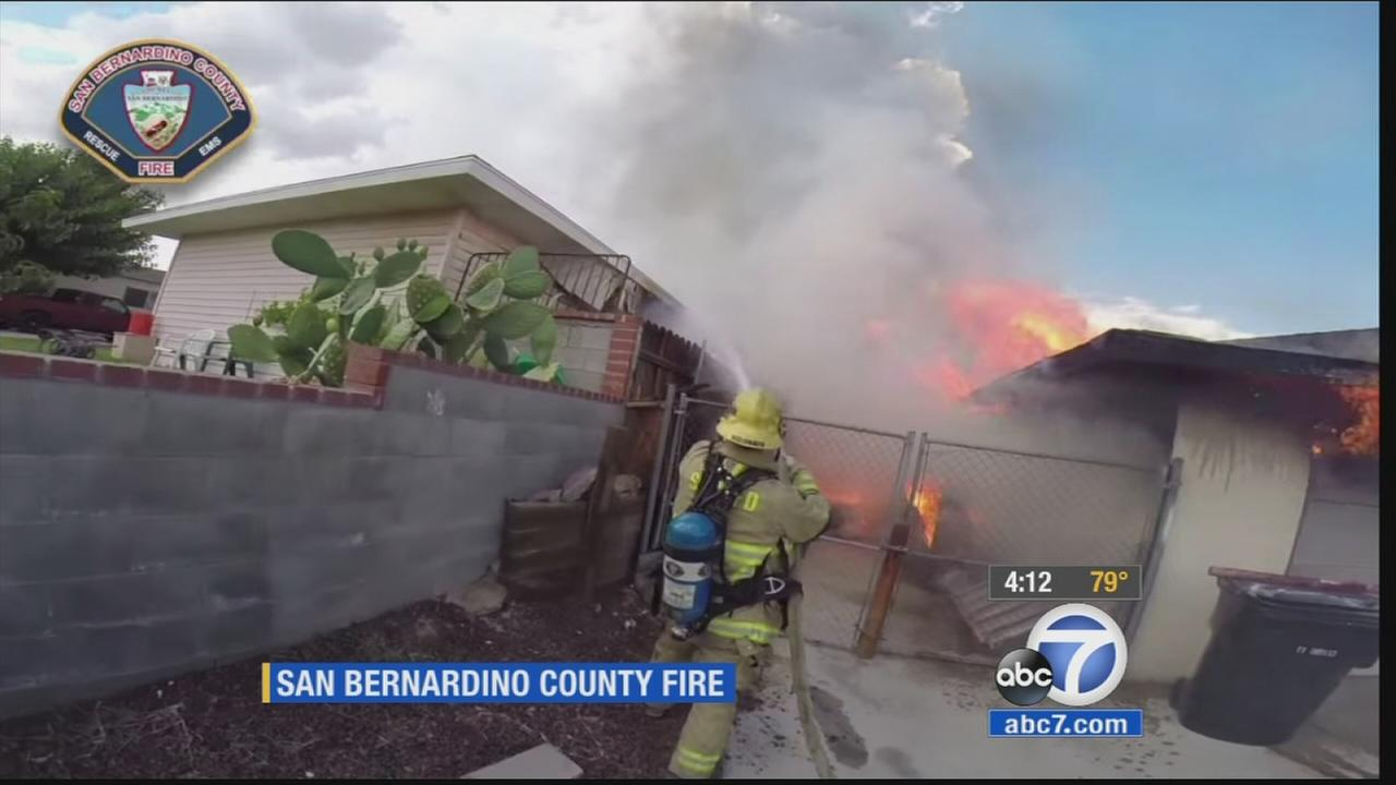 San Bernardino County firefighters respond to a house fire in the 15800 block of La Paz Drive in Victorville on Wednesday, July 29, 2015.