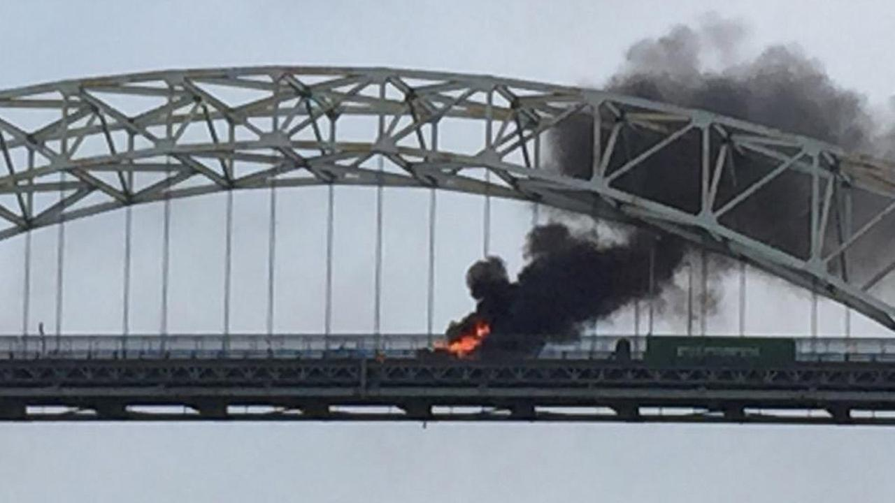A fire is shown after a multiple car crash on the Gerald Desmond Bridge in Long Beach on Saturday, Aug. 1, 2015.