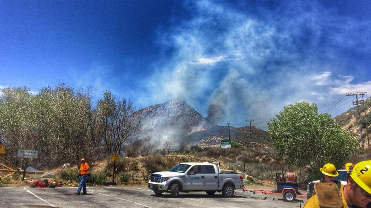 A fast-moving brush fire erupted in the Cajon Pass after a car crash on Saturday, Aug. 1, 2015.