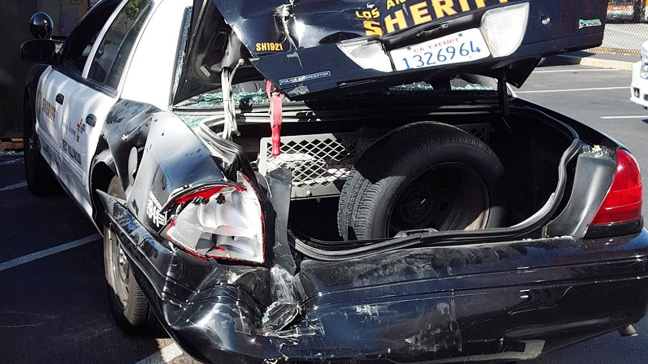 The mangled trunk of a Los Angeles County Sheriffs Department patrol car is shown after an SUV crashed into it in West Hollywood on Friday, July 31, 2015.