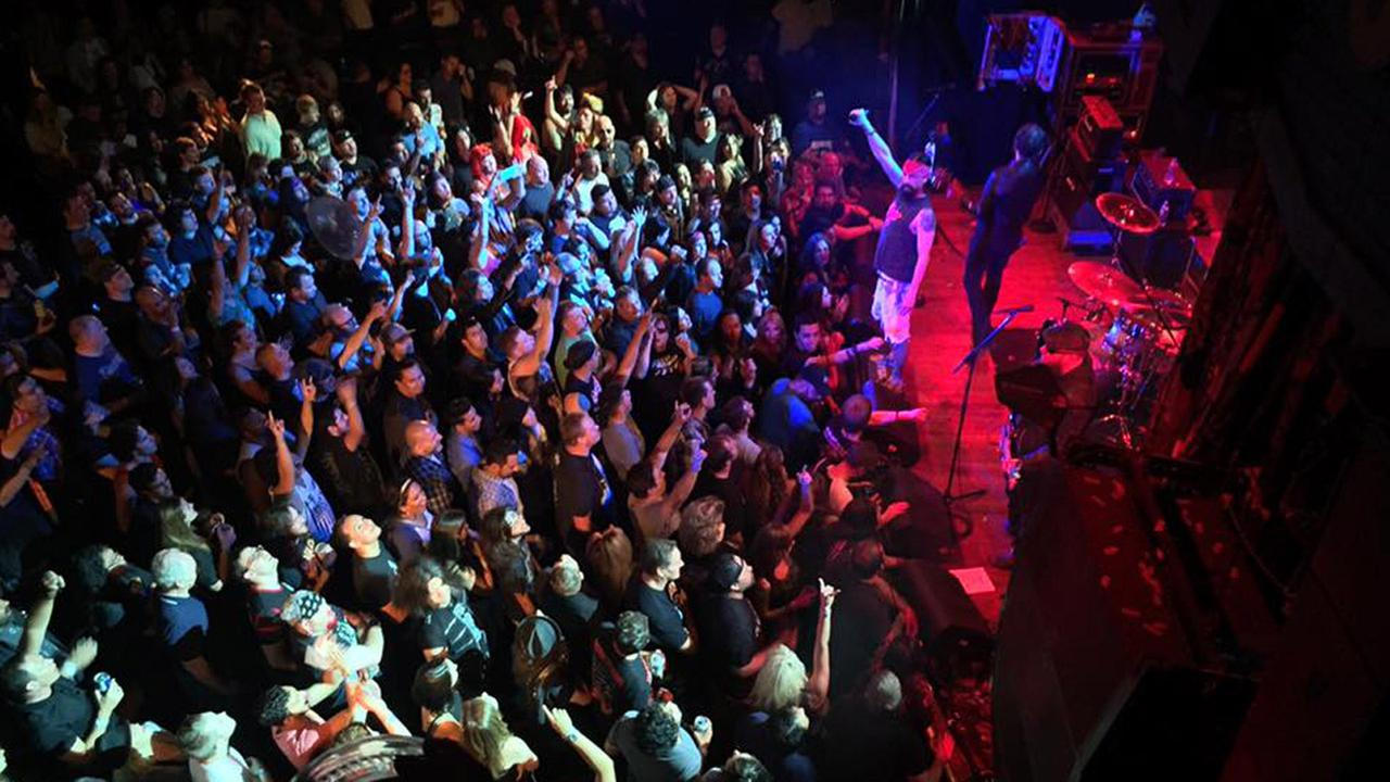 A large crowd enjoys the final concert played at the House of Blues on the Sunset Strip in Los Angeles on Monday, Aug. 3, 2015.