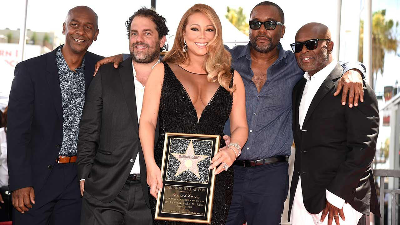 Stephen Hill, from left, Brett Ratner, Mariah Carey, Lee Daniels and L.A. Reid during a ceremony honoring Carey with a star on the Hollywood Walk of Fame on Wednesday, Aug. 5, 2015 in Los Angeles.Chris Pizzello/Invision/AP