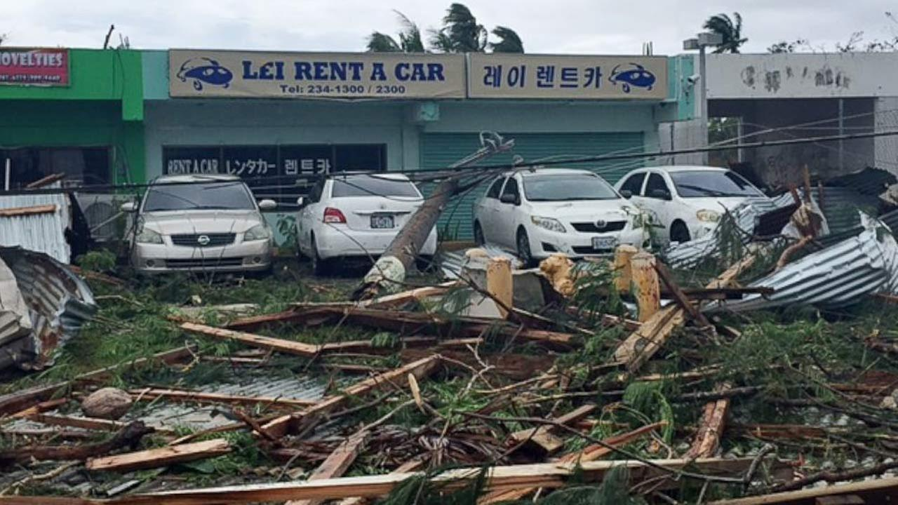 This Monday, Aug. 3, 2015 photo provided by Svetlana Hunter shows the storm damage to a shopping area in Saipan, Northern Mariana Islands.