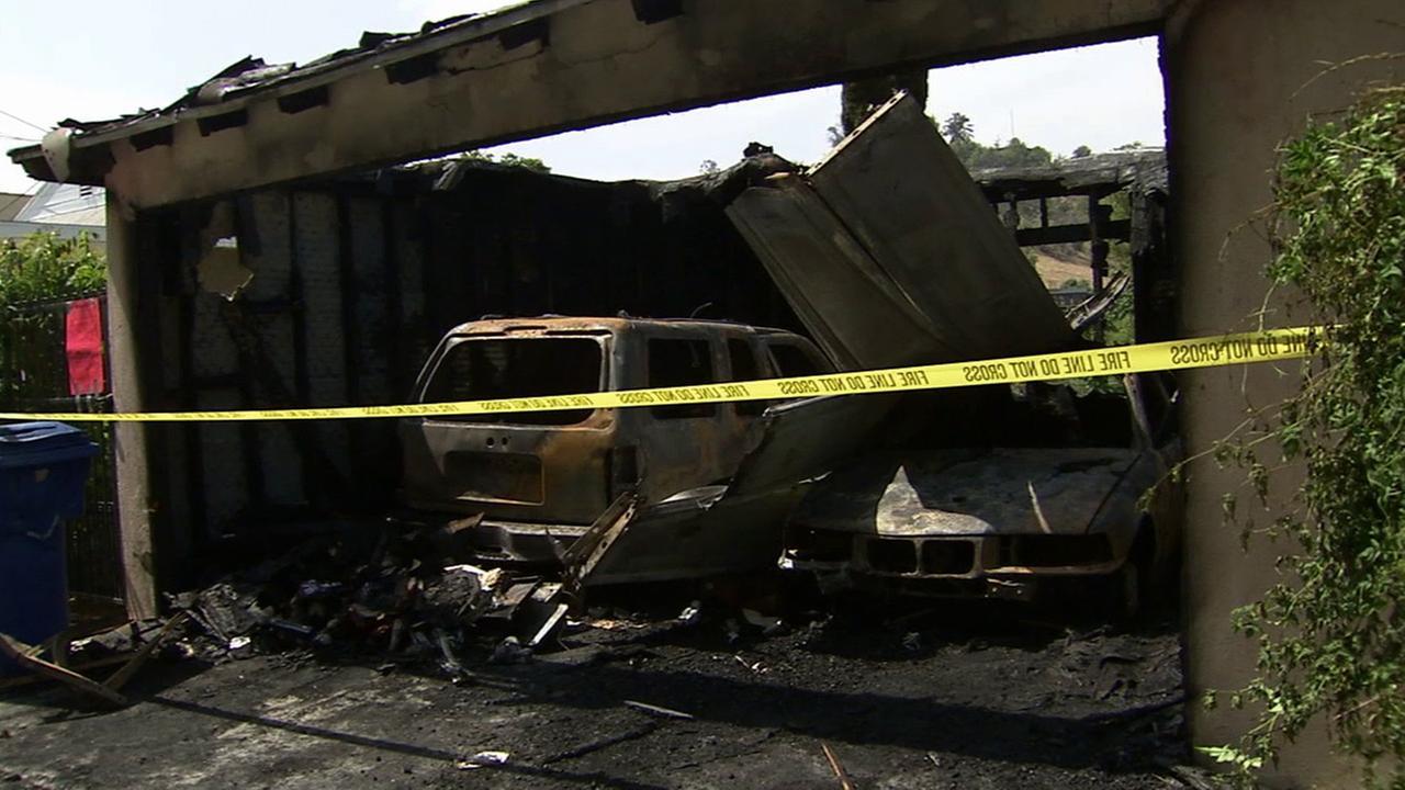 Flames devoured a detached garage in Mount Washington on Sunday, Aug. 9, 2015.