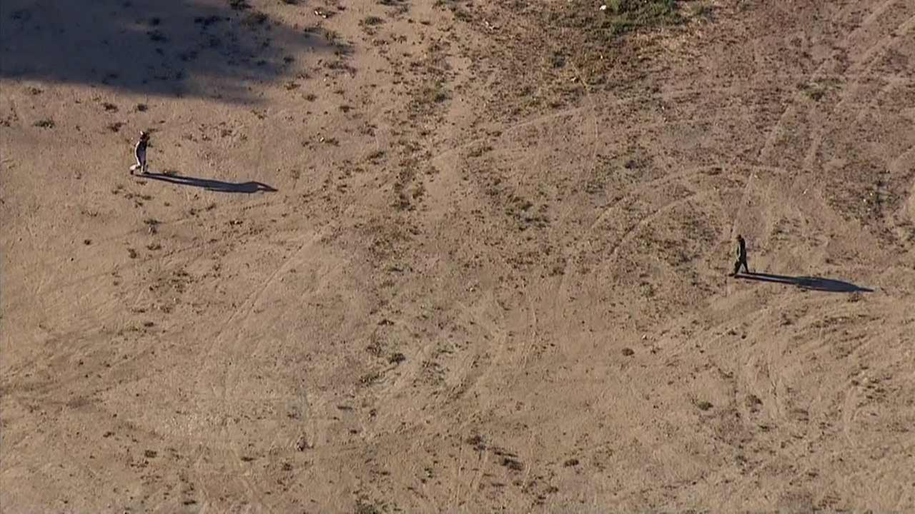 A Los Angeles County Sheriffs Department helicopter pursued a man on a motorized glider after he allegedly dropped contraband over a prison in Castaic on Monday, Aug. 10, 2015.