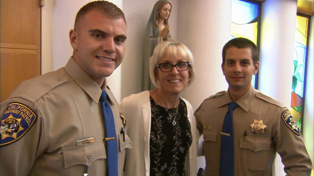 Kathy Byron poses for a photo with the CHP officers who helped save her life after she had a stroke while driving.