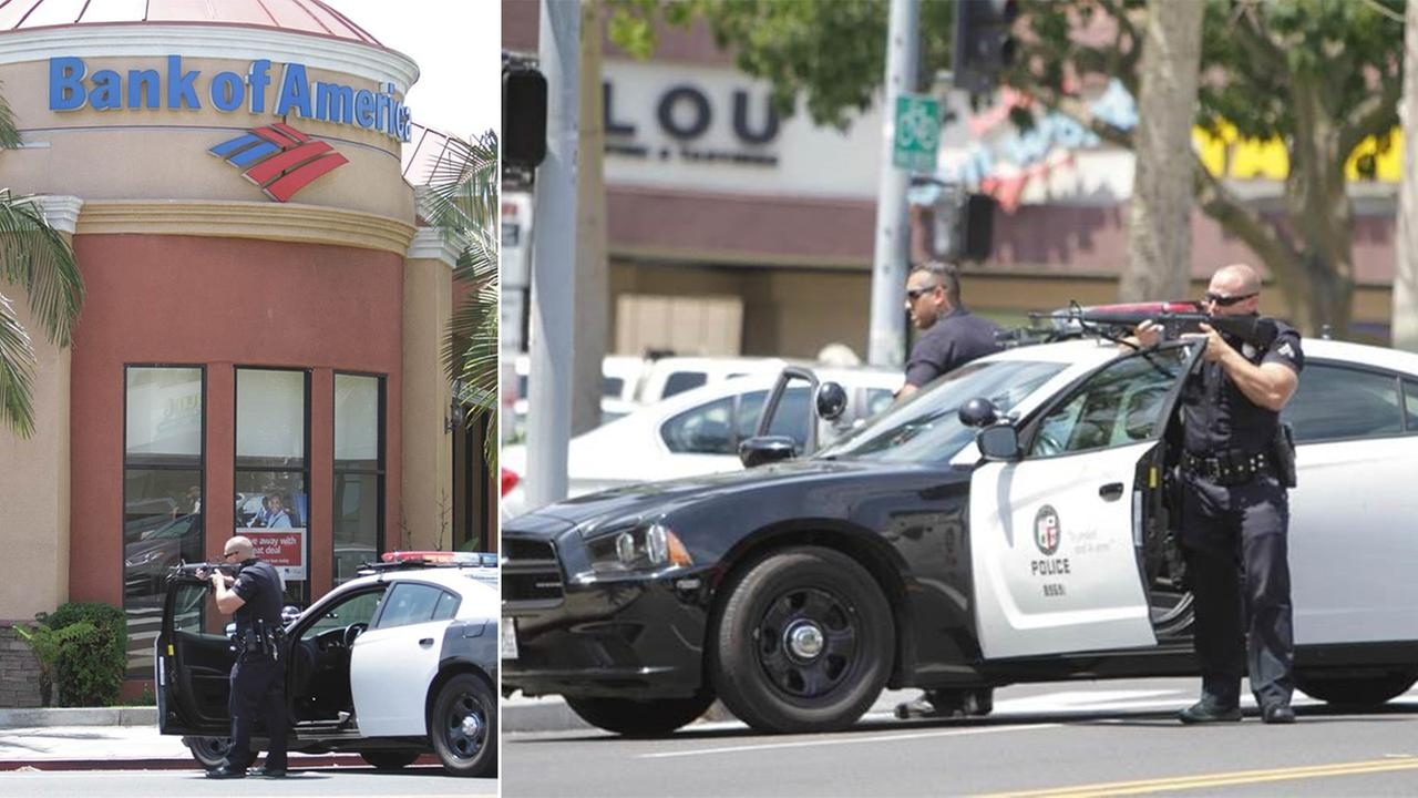 Los Angeles police officers aim their guns during a robbery at a Bank of America in Los Feliz on Thursday, Aug. 13, 2015.