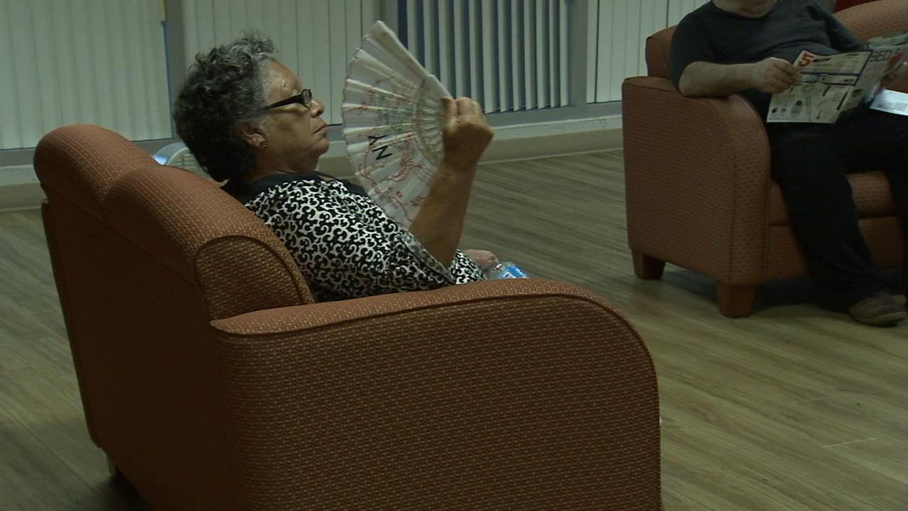 A senior citizen living at Fickett Towers in Van Nuys fanned herself to keep cool during a heat wave on Saturday, Aug. 15, 2105.