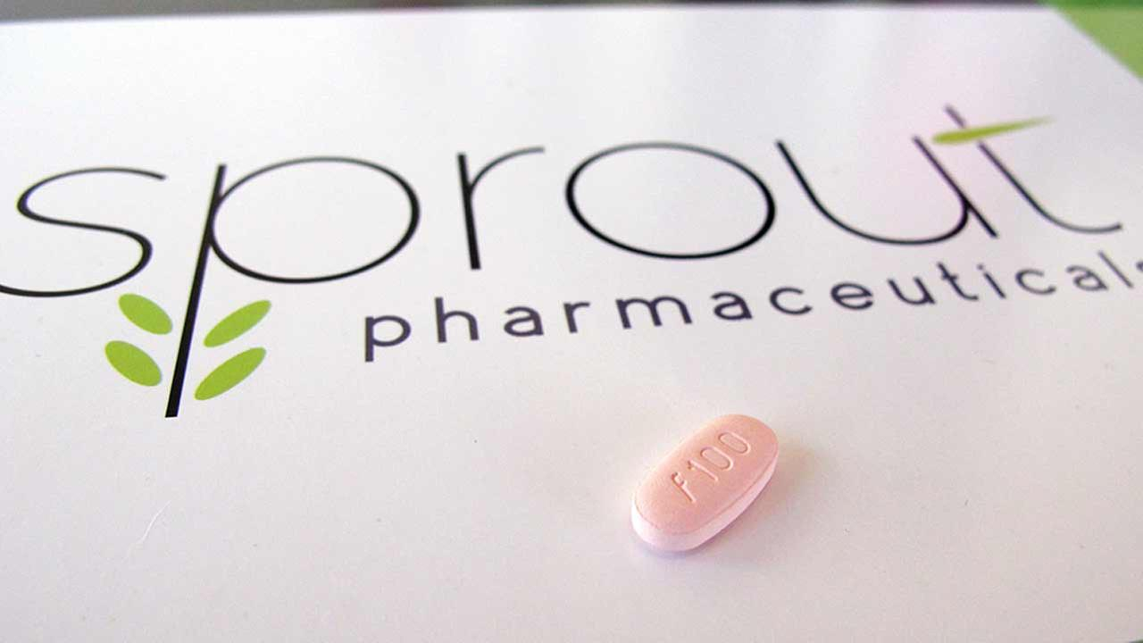 In this June 22, 2015, photo, a tablet of flibanserin sits on a brochure for Sprout Pharmaceuticals in the companys Raleigh, N.C., headquarters.