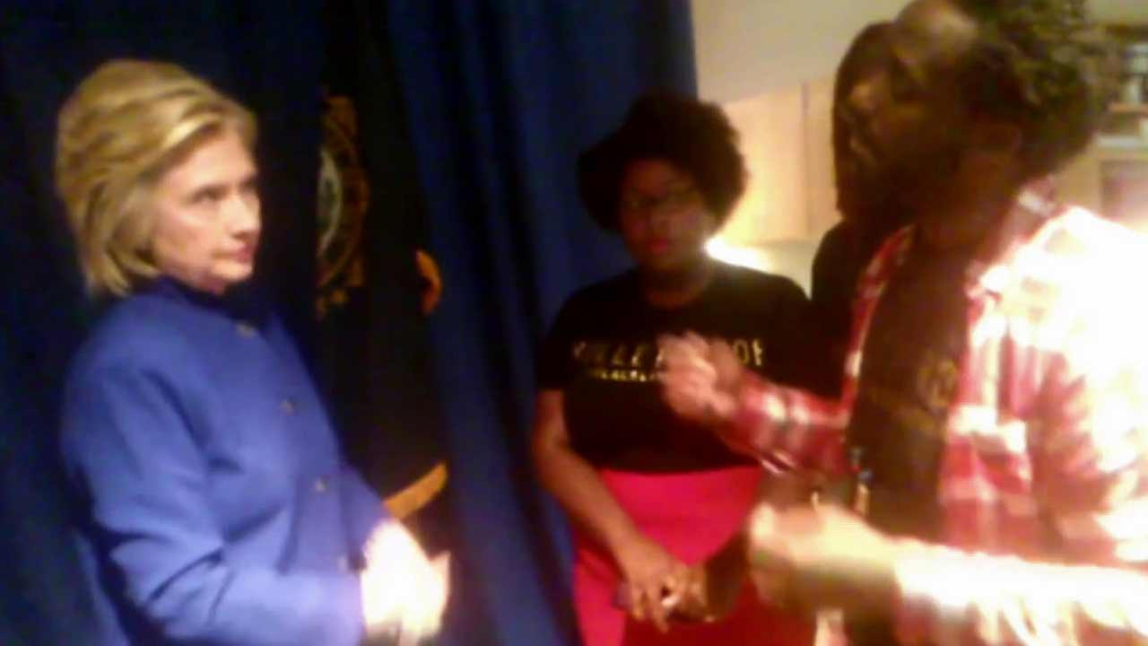 Democratic presidential candidate Hillary Rodham Clinton speaks to activists from the Black Lives Matter movement following a town hall meeting in New Hampshire.