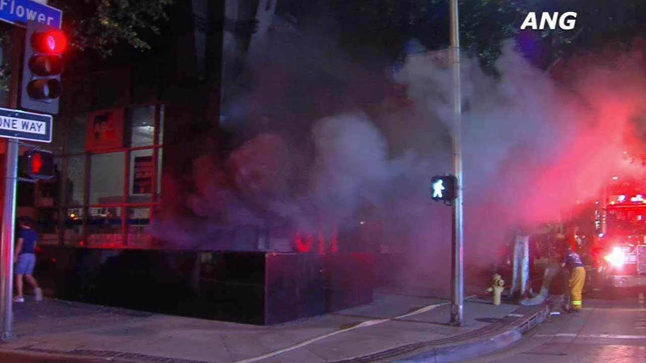 Smoke billows out after an electric generator erupted at the base of a high-rise building in the 800 block of Flower Street in downtown Los Angeles on Thursday, Aug. 20, 2015.