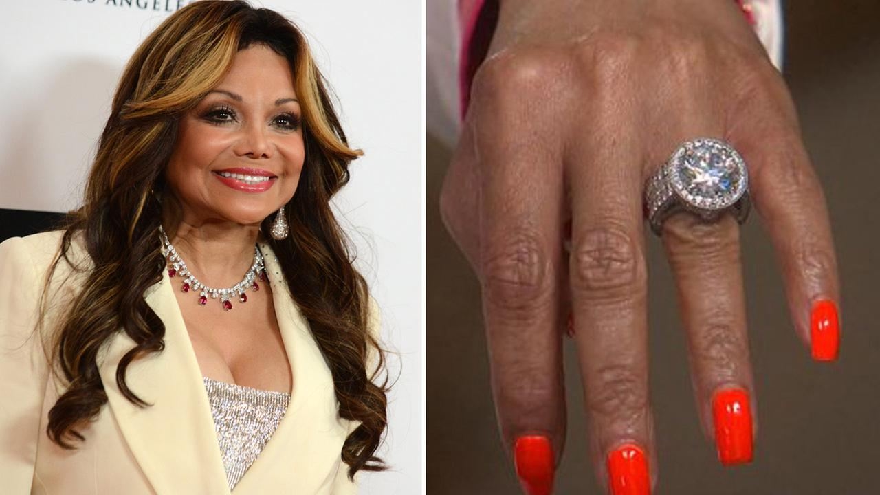 La Toya Jackson at the Love to Erase MS event in Los Angeles on Friday, May 3, 2013. /  Jackson shows off her engagement ring during a GMA interview on Wednesday, June 4, 2014.